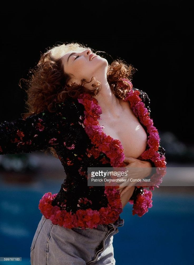 News Photo : Madonna wearing a jacket edged in silk flowers by...