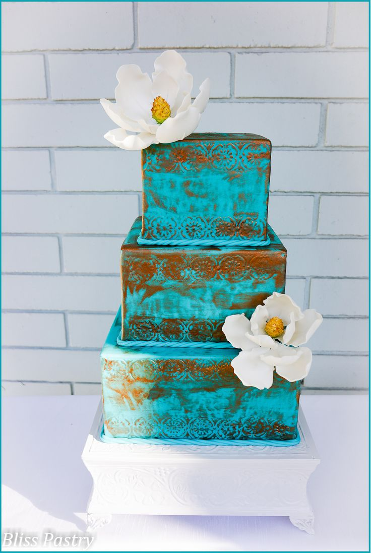 Verdigris and Magnolia Wedding Cake - Weathered copper and teal with white magnolias for a bright yet antique look.