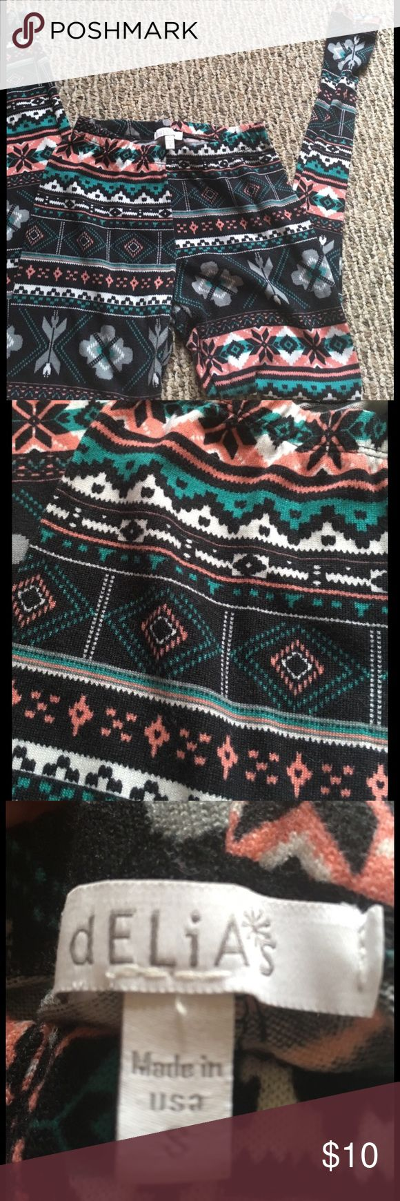 Tribal Print Leggings These patterned leggings are so comfy. The material is super soft and it feels like a cloud. The prints will compliment you in every way and so will the colors on these bad boys. delias Pants Leggings