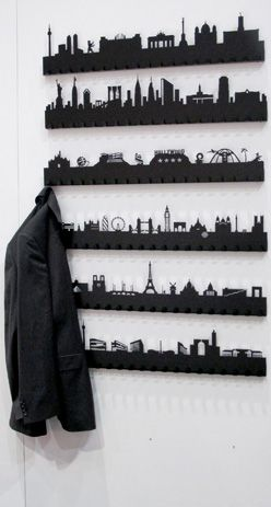 Laser etched landmark skyline on wall mounted coat rack by Radius Design. I'd do a different skyline and hang them differently.
