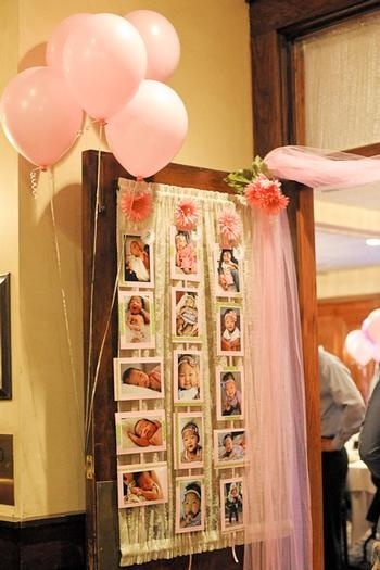 Take a picture every month for the first year of the baby being born and hang it up at her first birthday party.