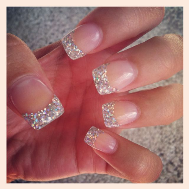 Just got my nails done, silver glitter tips.