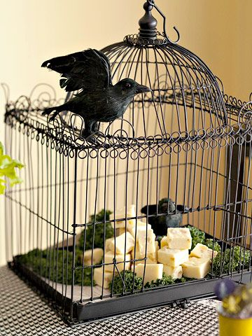 Snacks in a creepy birdcage - this is a great way to display Schwan's snacks at your Halloween party!