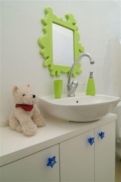 Sometimes a few minor changes are all you need to make your second bathroom a kid-approved space. New cabinet knobs, a green Ikea Barnslig Mirror ($35), and green bath accessories won't cost mama much but will make a big impact in her kiddo's bathroom! Source: Batim Studio
