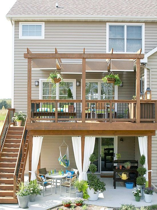 Wow! this could be done to our walkout basement Craftsman!! Two-In-One Outdoor Room    Blend the rest of your backyard to stage a perfect space for outdoor living. A walk-out patio below the deck offers additional seating in the shade with a dining set and hammock swing. Fabric curtains give the option of creating more privacy or blocking sunlight.