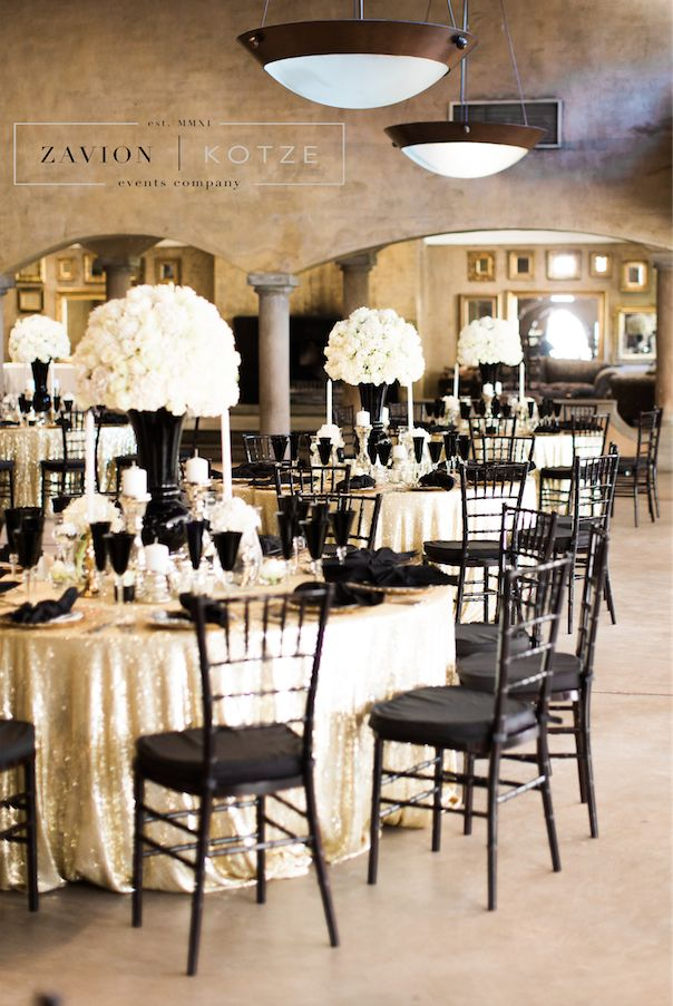 Gatsby inspired wedding with black and white décor. White roses and white orchids. Black tiffany chairs, Great Gatsby, rare wedding, special wedding, wedding of the year. White flowers, white mass arrangements, white floral arrangement, candle light.