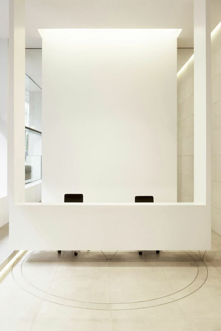 Front desk reception area - simple, clean and modern - Could use large wall art or company logo behind desk - Van Haren Office