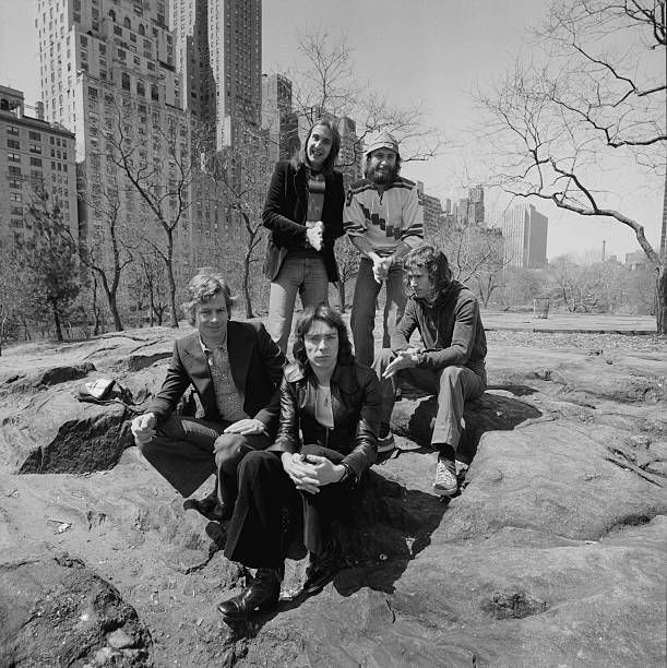 English progressive rock group Genesis in Central Park New York City 20th April 1976 Clockwise from front centre guitarist Steve Hackett drummer Bill...