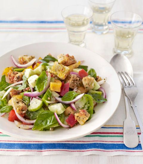 Instead of day-old crusty bread, this recipe calls for leftover pizza with fresh vegetables for a twist on the traditional Italian salad. Recipe: Panzanella Salad