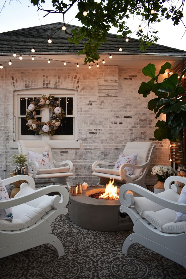 Gorgeous Classico Limewash on the brick setting the stage for a relaxing, outdoor patio by @kindredvintage. Available at Home Depot.