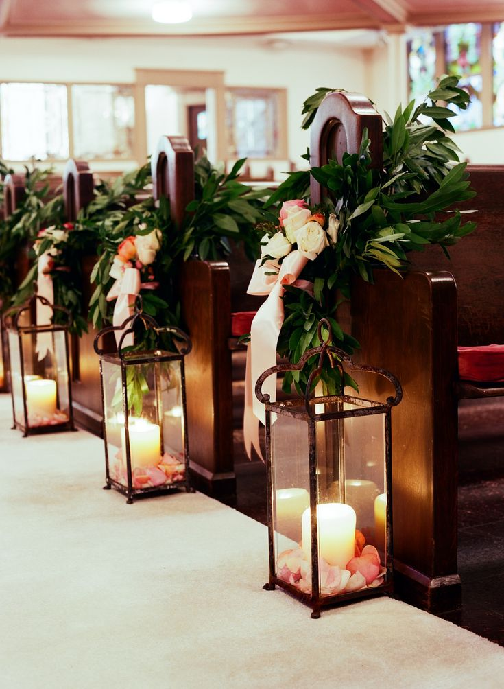 Ceremony Aisle With Greenery And Wrought Iron Lanterns