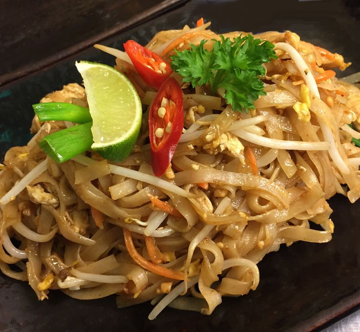 Phad Thai Noodles. A traditional Thai sweet and sour dish of fried ...