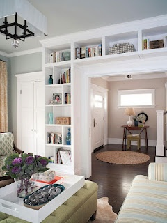 BOOKSHELVES AROUND DOOR. I like the idea of shelves going over the door in our library.