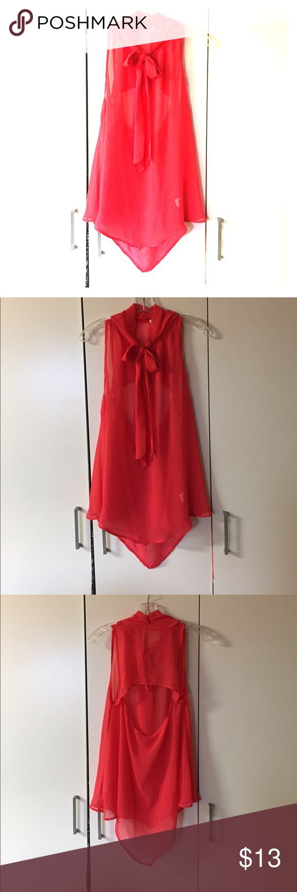 Long red/coral blouse Really nice long red/coral blouse. Has and open back. Can be dressed up or dressed down. It looks really cute with tights and long boots for fall, or shorts and tube top for summer. Tank-top not included. Tops Blouses