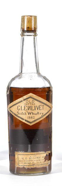 Old Vatted Glenlivet 1862 M.E. Bellows' Sons 3-part, BIM glass bottle. Some cracking of label. Small portion of lower label missing. Driven cork intact and tight, but some evidence of insect damage. Level: Low-shoulder. 25 1/2 F.oz. No proof stated.