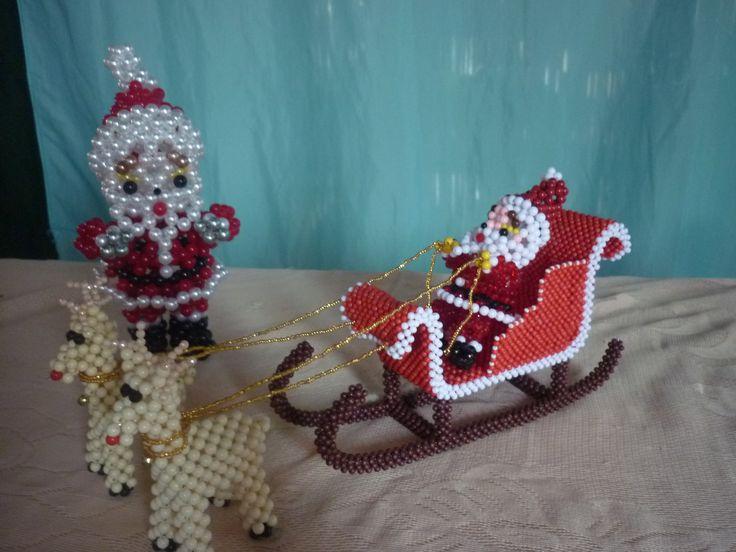 trineo navideño, santa claus elaborados en perlas