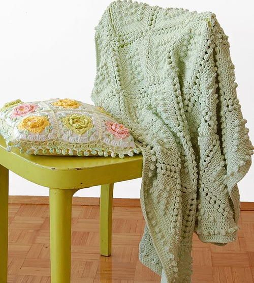 Vintage Popcorn Stitch Blanket | This elegant green blanket features the crochet popcorn stitch with a vintage twist.