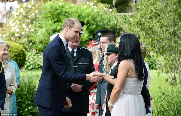 The Duke of Cambridge proved he truly is Prince Charming as he greeted various guests at the garden party this afternoon