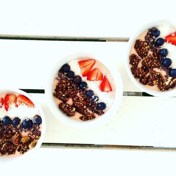 Strawberry granola breakfast bowl! Topped with coconut and chia seeds! Recipe online! #fruit #healthyeating