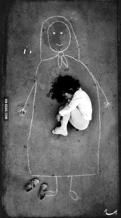 An Iraqi girl in an orphanage - missing her mother, so she drew her and fell asleep inside her. Very sad...
