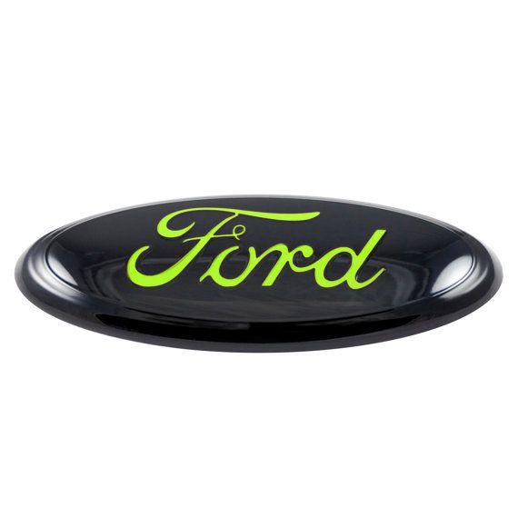Customize your ride with this bold black and neon green Ford emblem!