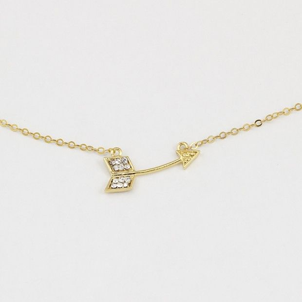 <p>A Beautiful necklace featuring a curving arrow element made of 24k gold plated brass and set with swarovski. the chain and clasp are made of 24k gold plated goldfilled.</p>