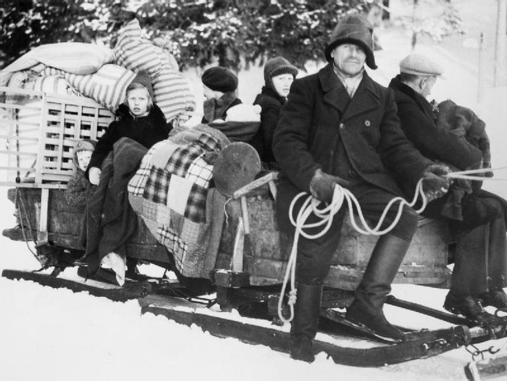 A family leaving their home in the ceded Finnish territory which became part of Russia, at the end of the WinterWar