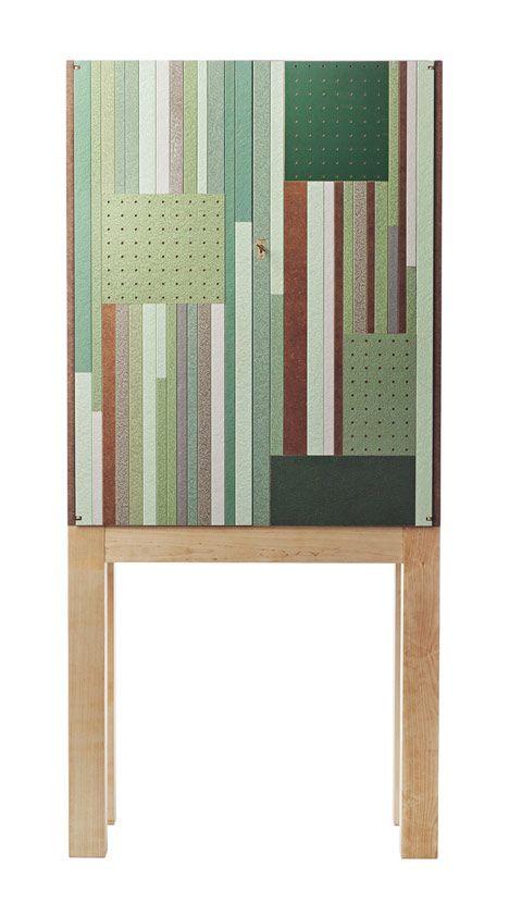 Swedish designers Folkformhave used 80-year-old samples of hardboard in these cabinets for Swedish interiors brandSvenskt Tenn.