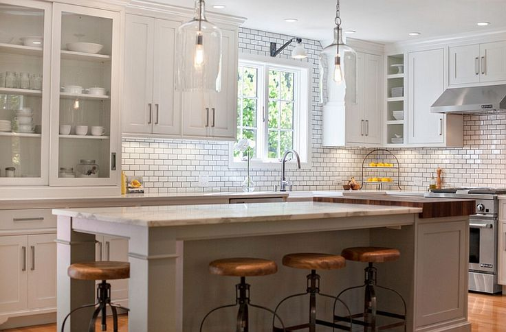Apothecary-style cabinets in white in the modern kitchen
