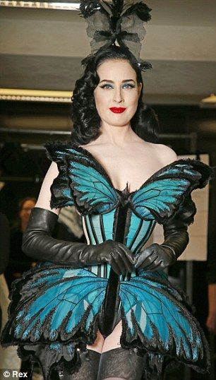 The perfect fit: Burlesque dancer and model Dita Von Teese was Gaultier's muse in Paris today in a spectacular butterfly corset.
