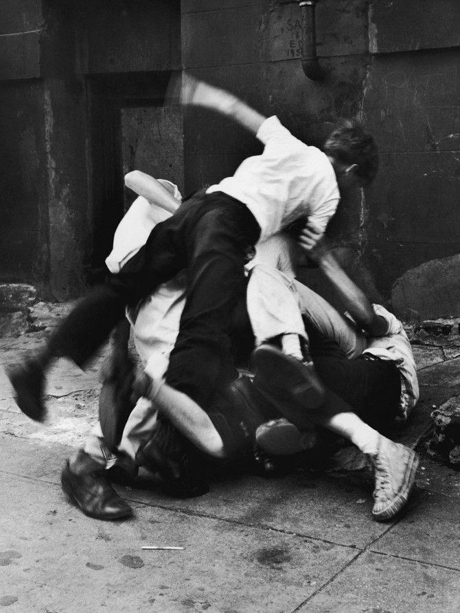 group of boys fighting in a heap/ outdoors, n.d.    photo by FPG (via getty images)