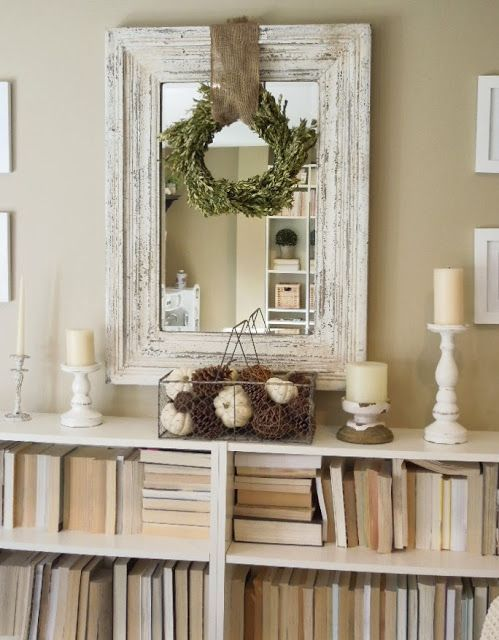 Love the rustic mirror and wreath over it.