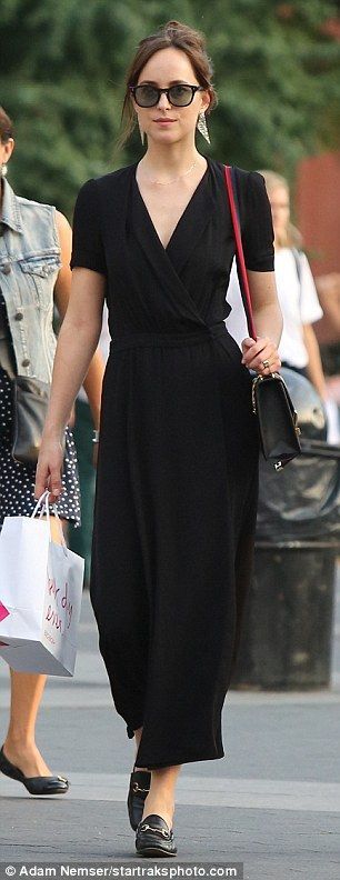 'Best day ever': Black leather brogues artfully matched her buckled over-the-shoulder bag...