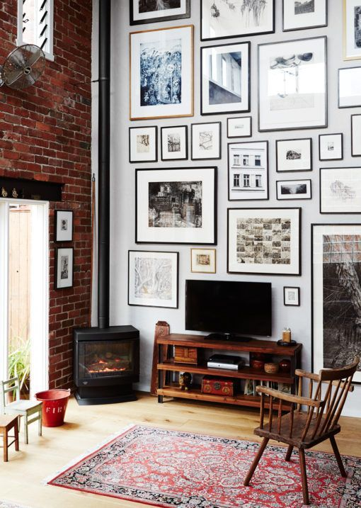 TV + double height gallery wall