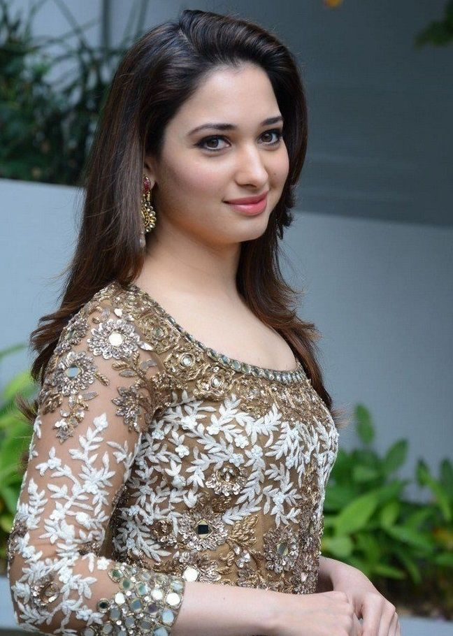 south indian girl tamannaah smiling face stills in green dress at