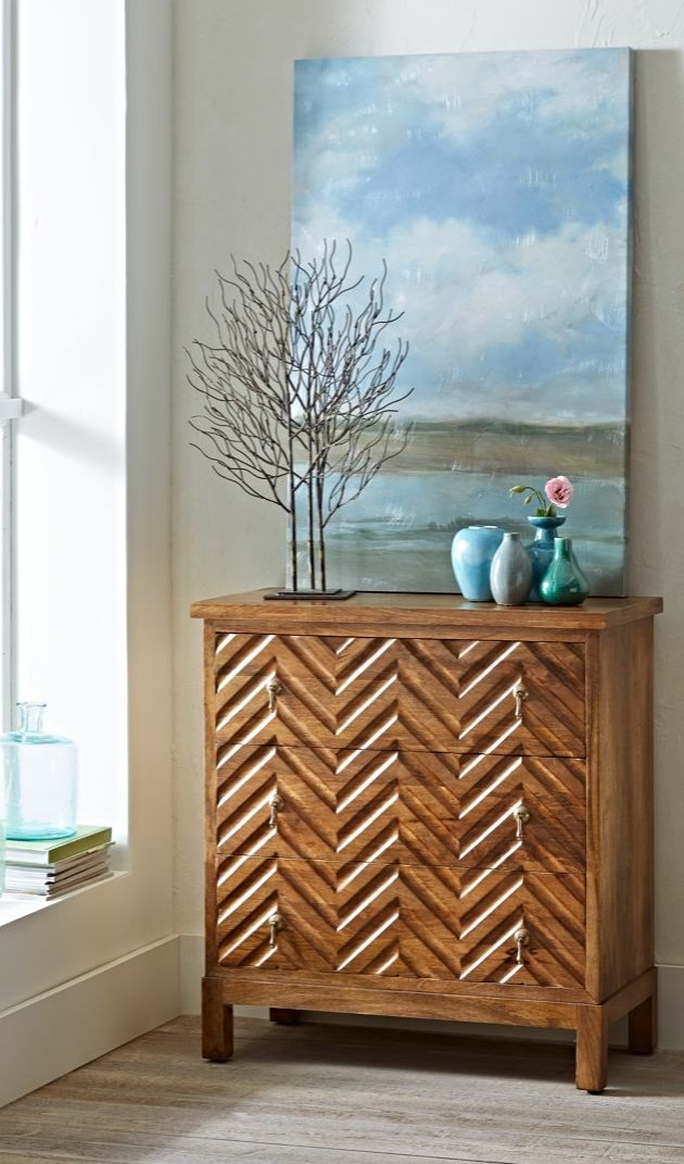 Solve storage and design challenges with one unique chest of drawers. Our Chevron Wood Chest is worthy of prominent display, but is sized to fit into an unused corner.