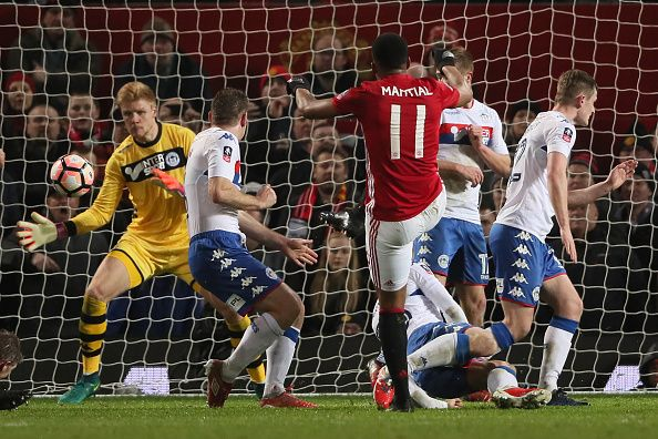 Anthony Martial of Manchester United scores a disallowed goal during the FA Cup fourth round match between Manchester United and Wigan Athletic at...
