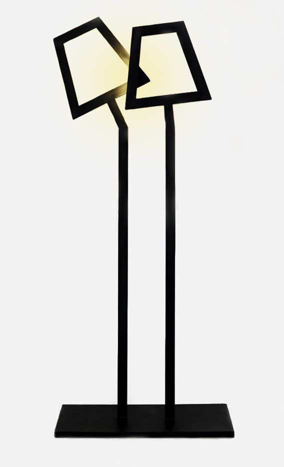 In and Out Floor Lamp  by TRE Studio . Classic but with an eye for the contemporary, this In and Out Floor Lamp brings a unique atmosphere to the space. The vertical illumination glistens with a comfortable light, and easily fits the aesthetics of any room. The steel sprayed in black finish creates a bold outline to the core of its design. http://zocko.it/LDsxX