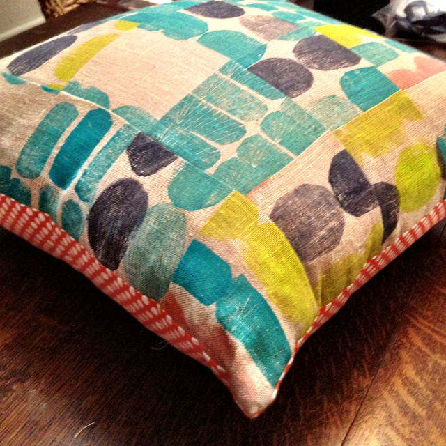 Potato printed patchwork with coral polka dot on reverse side.