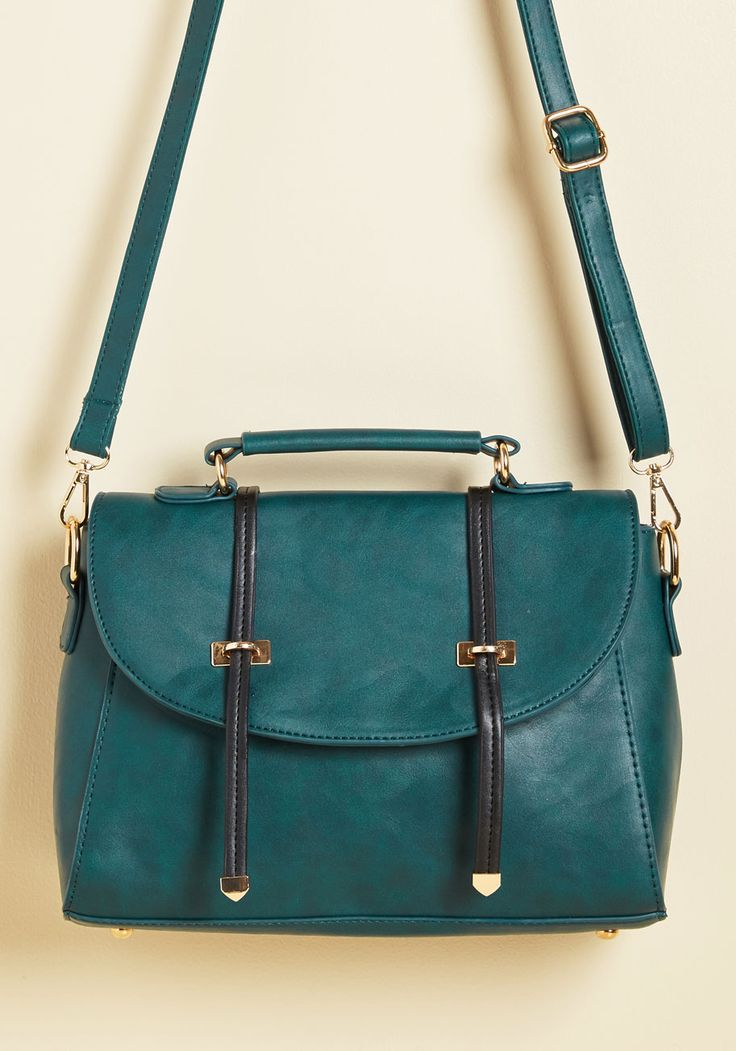 Apt Employee Bag | Mod Retro Vintage Bags | ModCloth.com  Be prompt, prim, and on your way to a promotion by sporting this faux-leather bag into the office. Detailed with golden accents, decorative black straps, and a rich teal hue, this structured satchel is guaranteed to get your hard day's work noticed by your higher-ups!