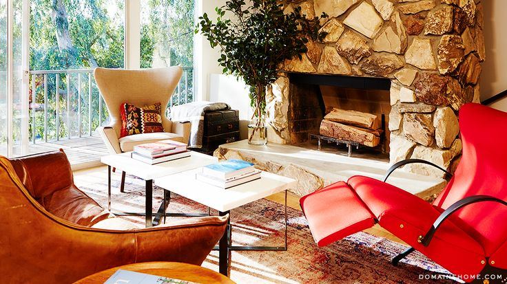 11 Styling Tricks to Make Your Home Look Like a Magazine // red lounge armchair, Papa Bear wingchair, leather lounge chair, white coffee table, stone fireplace