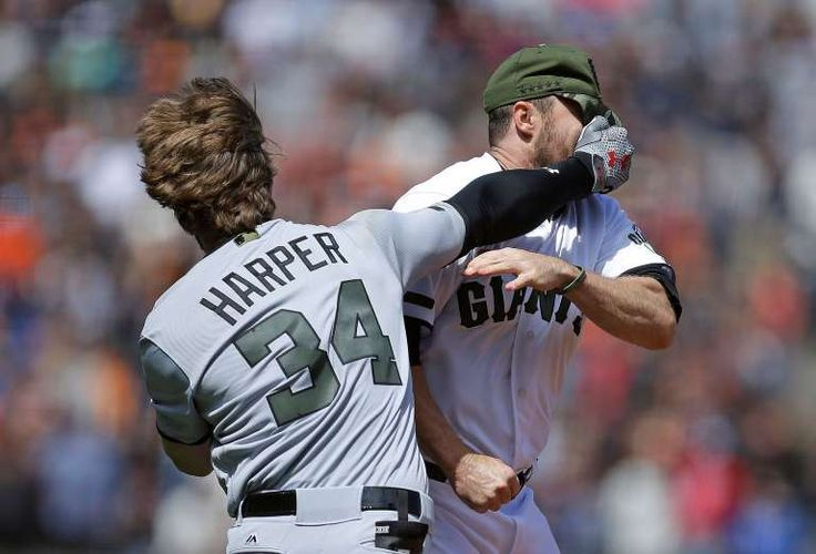 HIT BATTER HITS PITCHER:  Washington Nationals' Bryce Harper, left, hits San Francisco Giants' Hunter Strickland in the face after being hit with a pitch in the eighth inning on May 29 in San Francisco. The Nationals won 3-0.