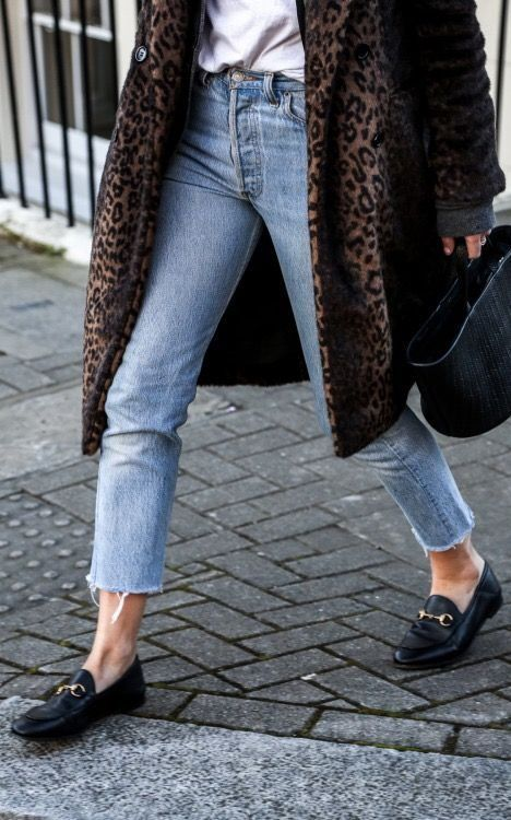 Classic vintage jeans paired with loafers and faux fur longline coat