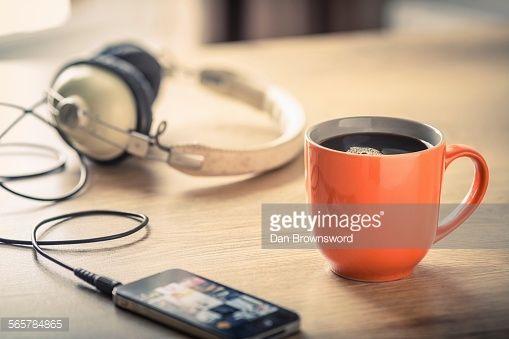 Stock Photo : Still life of black coffee, headphones and smartphone