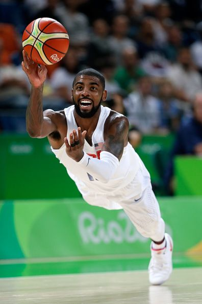 Kyrie Irving of United States passes the ball to teammate Kevin Durant not…