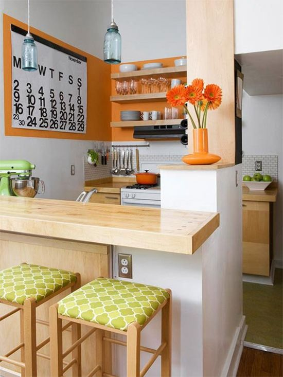 Love this tiny remodeled kitchen with pops of orange and green color. Click through for the sweet blog (Poor & Pretty).