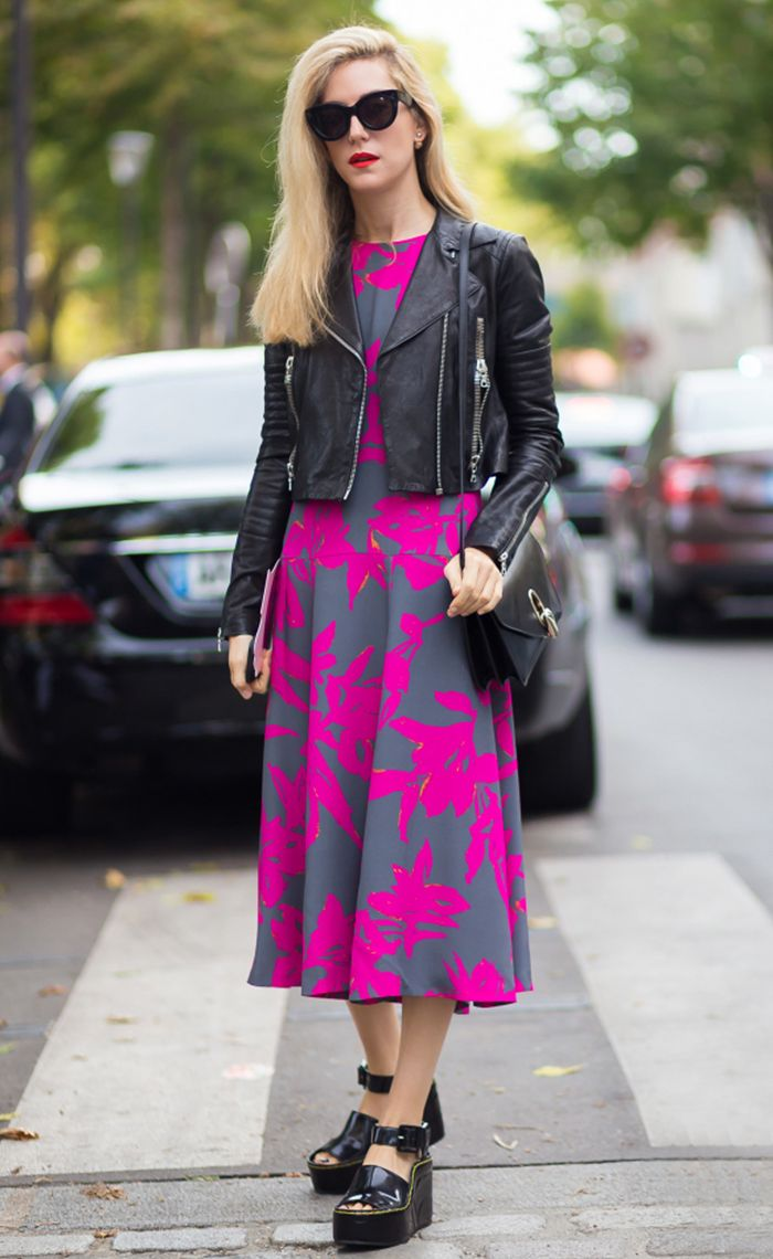 Joanna Hillman in vibrant pink floral maxi and leather jacket with sunglasses and shoulder bag