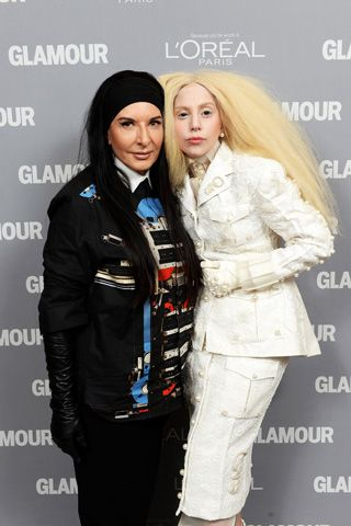 Marina Abramovic, in Givenchy, and Lady Gaga, in Thom Browne.