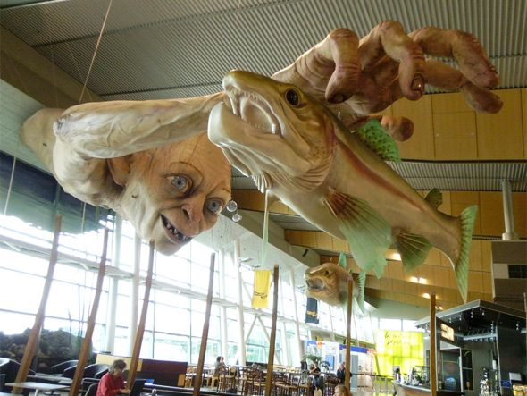 It's not weird at all that the airport in Wellington, New Zealand would be home to a Lord of the Rings statue in the first place… but a ginormous Gollum coming out of the wall and reaching across the room for a similarly oversized fish? That's unexpected. And awesome. And also kind of creepy.