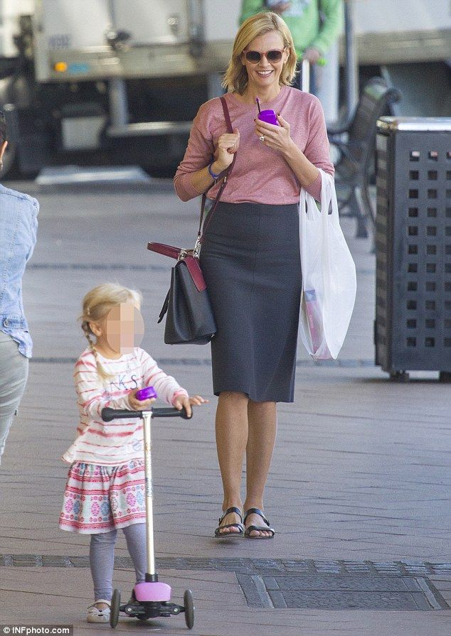 Pretty in pink: Sarah Murdoch was seen running errands with her four-year-old daughter Aer...